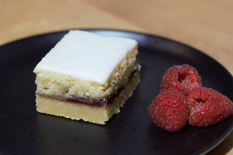 Bakewell shortbread slices - shortbread biscuit base, jam centre, frangipane layer and icing top