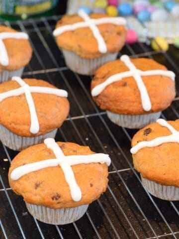 hot cross bun muffins with golden syrup glaze and icing cross