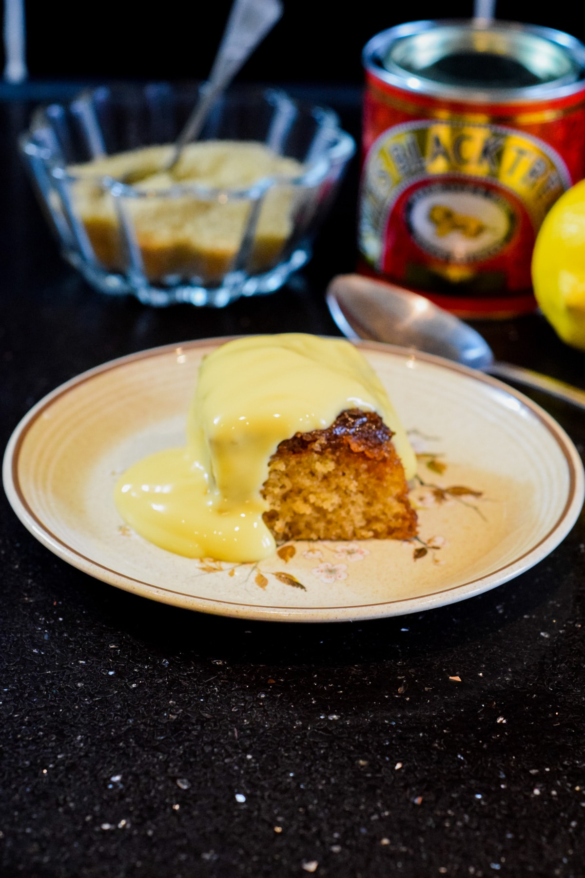 Hot treacle sponge pudding recipe with black treacle and golden syrup. Served with custard