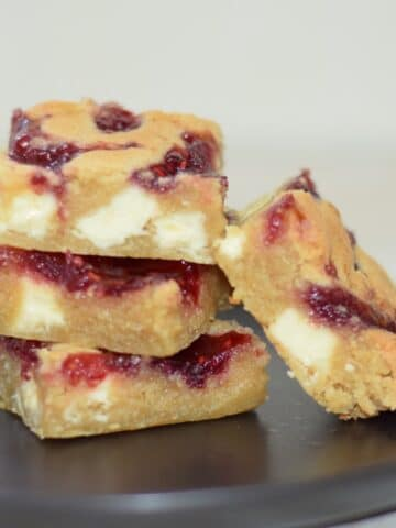 Bakewell cookie bars recipe with white chocolate chips and jam