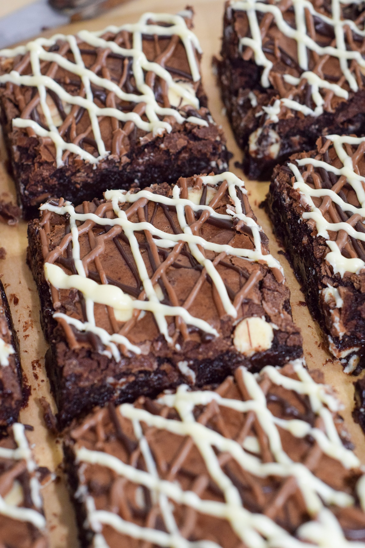 Fudgy triple chocolate brownie squares with triple chocolate drizzle