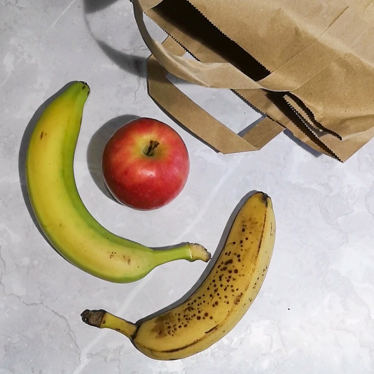 how to ripen bananas at home using the brown paper bag method