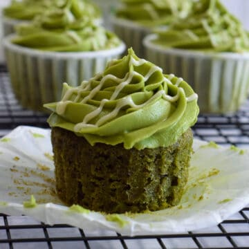 Matcha green tea cupcakes with a matcha buttercream frosting and white chocolate drizzle