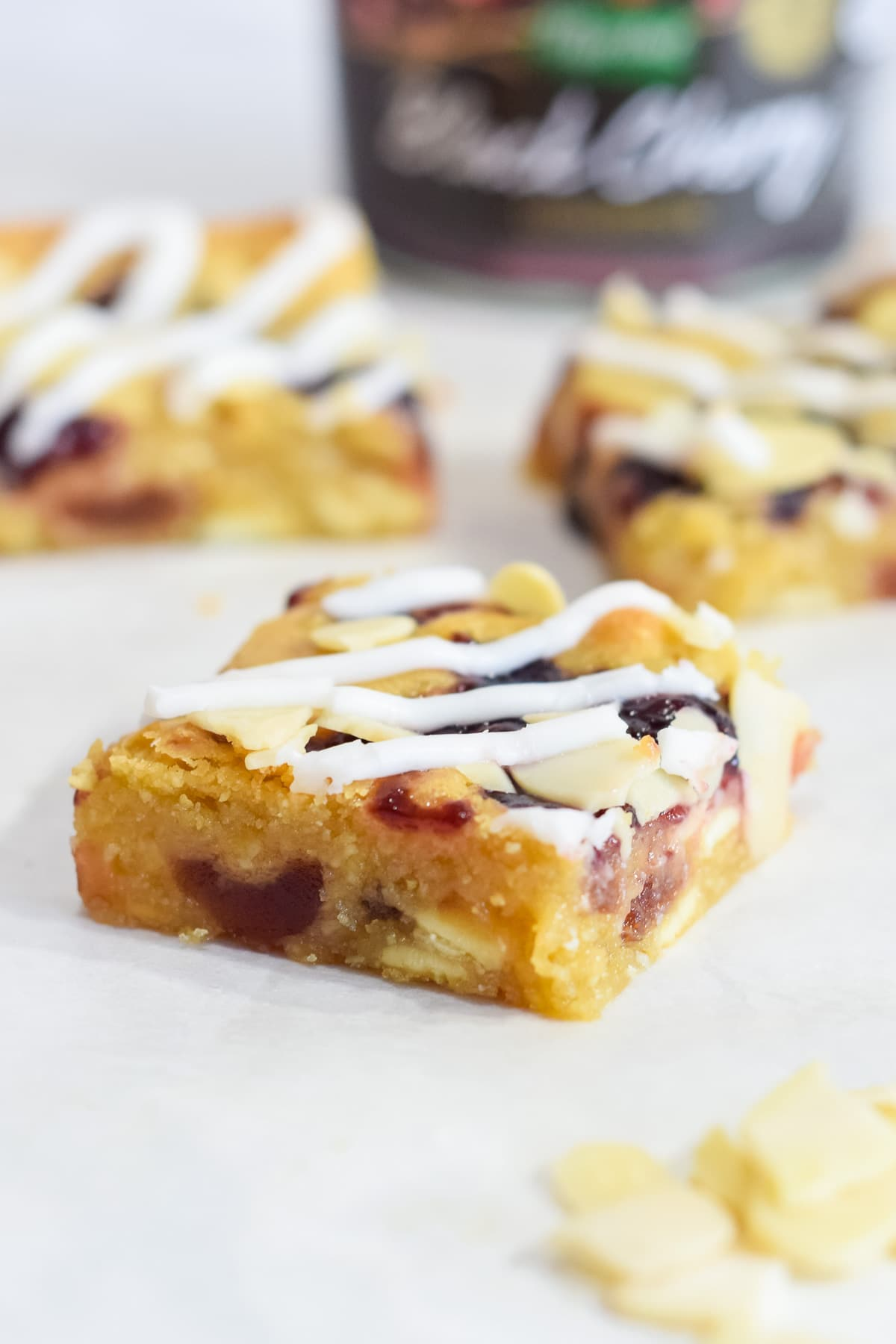 Double cherry Bakewell blondies squares recipe with glace cherries, cherry jam and white chocolate chips