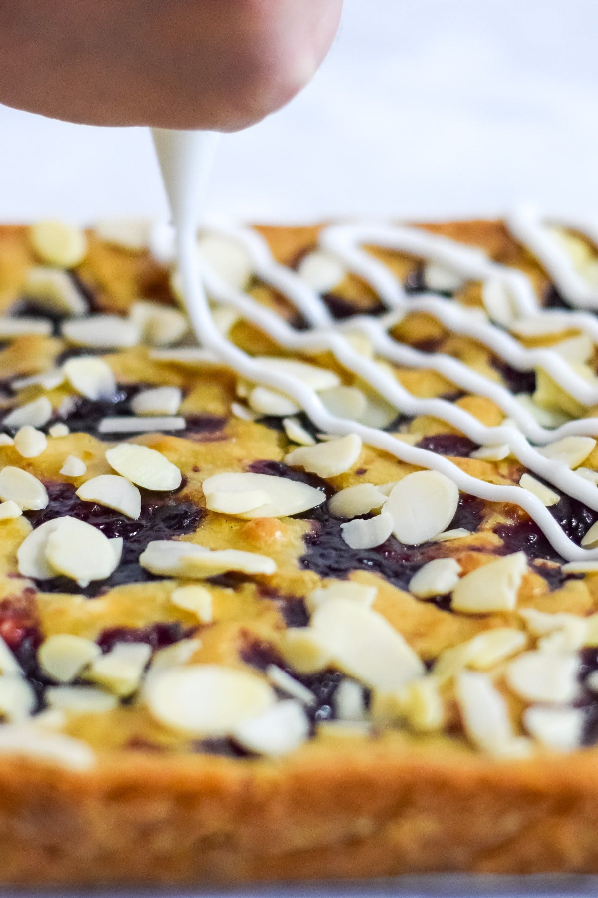 Double cherry Bakewell blondies squares recipe with white icing