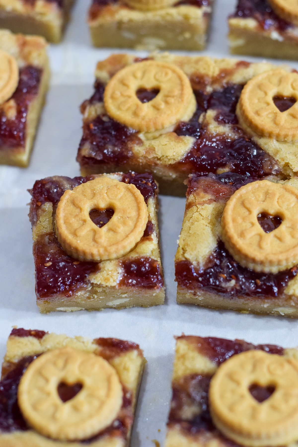 Mini Jammie Dodger blondies recipe with white chocolate chips and a jam swirl cut into squares