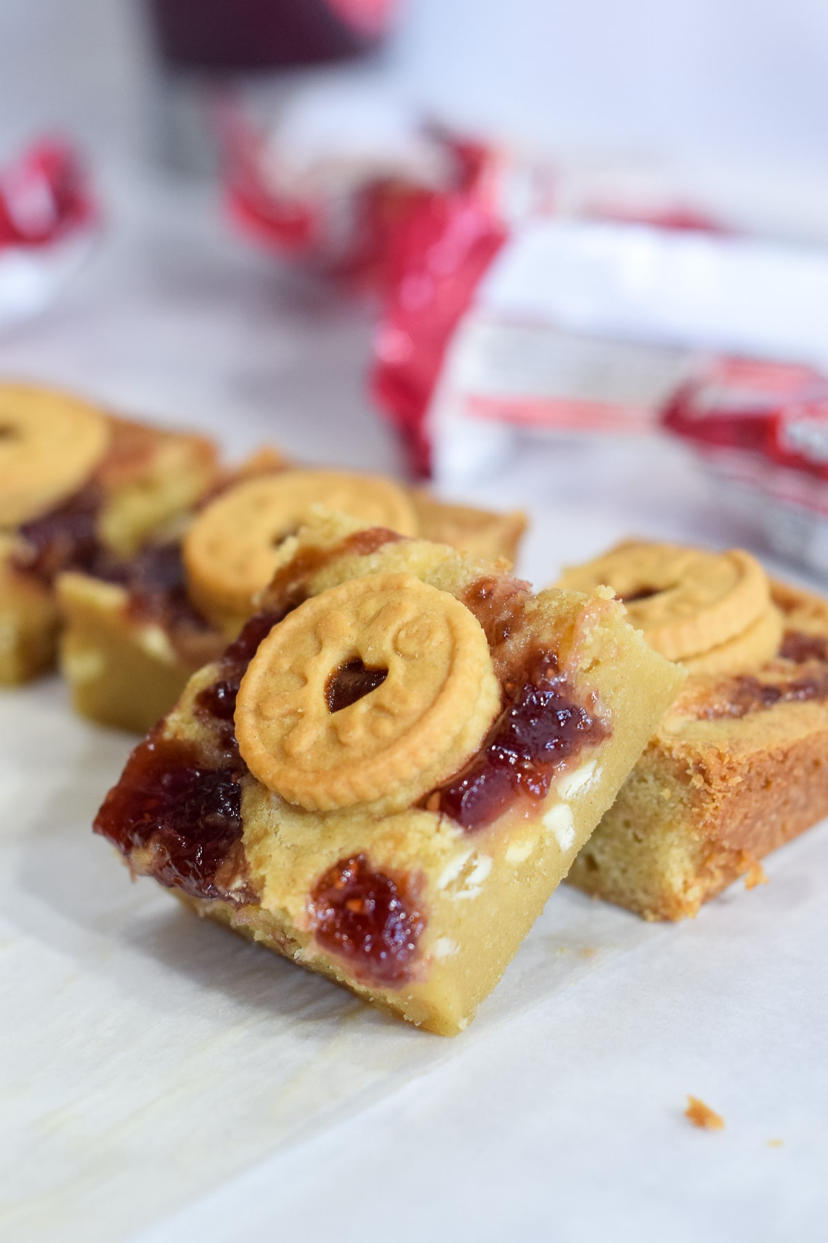 Mini Jammie Dodger blondies recipe with white chocolate chips and a jam swirl
