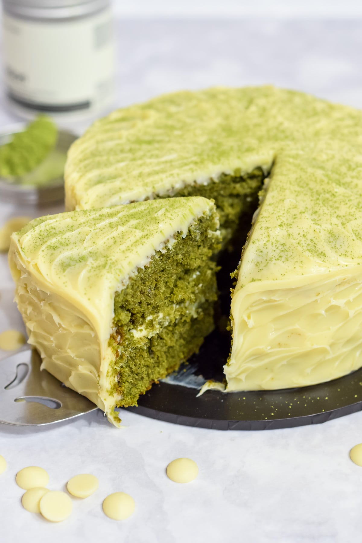 easy matcha green tea cake with white chocolate ganache frosting sliced